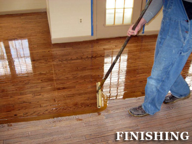 Epoxy being used on a timber floor